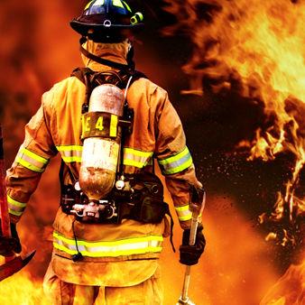 Firefighter facing a fire